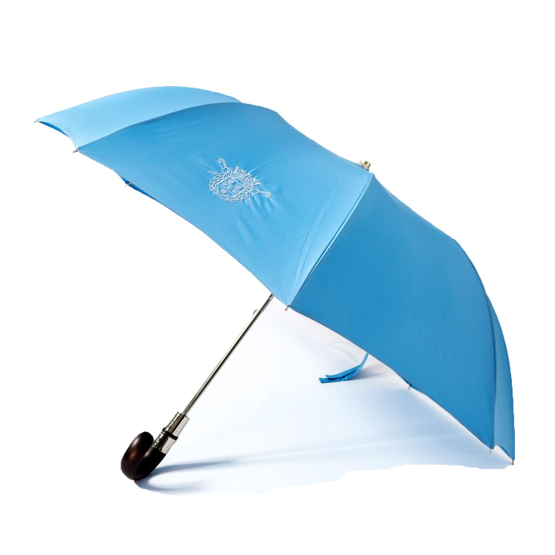 Le parapluie de Cherbourg Pliant, poignée courbe, bague chrome , en bleu ciel