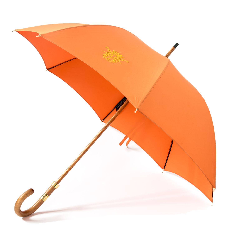 Le Parapluie de Cherbourg, le modèle Le Ville orange, ouvert, finitions or fin 18 carats.